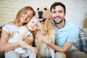 38889026 - modern family with dog looking at camera during home rest